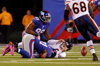EAST RUTHERFORD, NJ - OCTOBER 03:  Jay Cutler #6 of the Chicago Bears gets sacked by Justin Tuck #91 and Chris Canty #99 of the New York Giants at New Meadowlands Stadium on October 3, 2010 in East Rutherford, New Jersey.  (Photo by Michael Heiman/Getty I