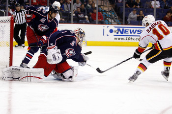 COLUMBUS, OH - OCTOBER 22:  Niklas Hagman #10 of the Calgary Flames beats goaltender Steve Mason #1 of the Columbus Blue Jackets for the first goal of the night during the first period on October 22, 2010 at Nationwide Arena in Columbus, Ohio.  (Photo by