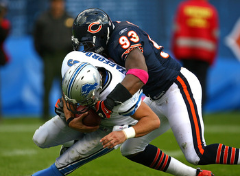CHICAGO - OCTOBER 04: Adewale Ogunleye #93 of the Chicago Bears sacks Matthew Stafford #9 of the Detroit Lions on October 4, 2009 at Soldier Field in Chicago, Illinois. The Bears defeated the Lions 48-24. (Photo by Jonathan Daniel/Getty Images)