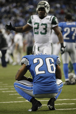 DETROIT - NOVEMBER 07: Louis Delmas #26 of the Detroit Lions reflects on the Lions overtime loss to the New York Jets at Ford Field on November 7, 2010 in Detroit, Michigan. The Jets defeated the Lions 23-20 in overtime.  (Photo by Leon Halip/Getty Images