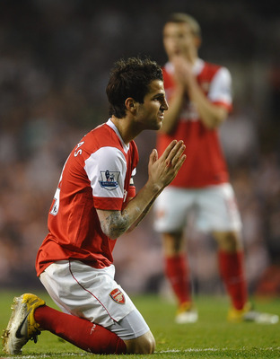 LONDON, ENGLAND - APRIL 20:  Cesc Fabregas of Arsenal reacts during the Barclays Premier League match between Tottenham Hotspur and Arsenal at White Hart Lane on April 20, 2011 in London, England.  (Photo by Laurence Griffiths/Getty Images)