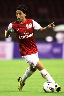 HANGZHOU, CHINA - JULY 16:  Samir Nasri of Arsenal in action during the pre-season friendly match between Hangzhou Greentown and Arsenal at Yiwu Meihu Stadium on July 16, 2011 in Hangzhou, China.  (Photo by Lintao Zhang/Getty Images)