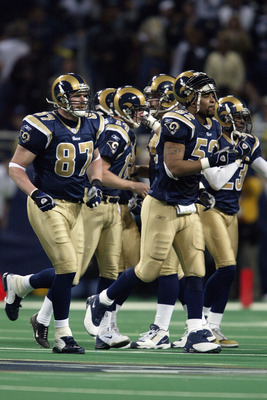ST. LOUIS - JANUARY10:  Special teams players of the St. Louis Rams run off the field during the NFC Divisional Playoff game against the Carolina Panthers on January 10, 2004 at the Edward Jones Dome in St. Louis, Missouri. The Panthers defeated the Rams