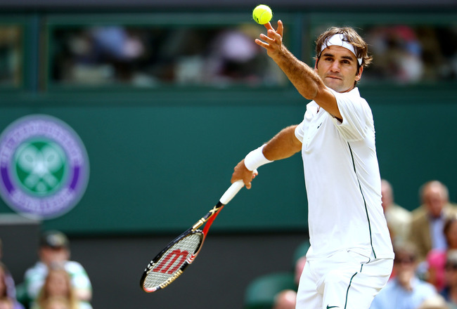 LONDON, ENGLAND - JUNE 29:  Roger Federer of Switzerland serves during his quarterfinal round match against Jo-Wilfried Tsonga of France on Day Nine of the Wimbledon Lawn Tennis Championships at the All England Lawn Tennis and Croquet Club on June 29, 201