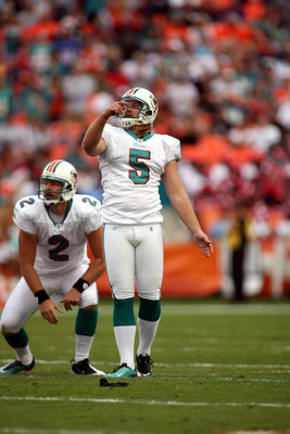 MIAMI - DECEMBER 19:  Kicker Dan Carpenter #5  reacts to missing a field goal late in the game against the Buffalo Bills at Sun Life Stadium on December 19, 2010 in Miami, Florida. The Bills defeated the Dolphins 17-14.  (Photo by Marc Serota/Getty Images