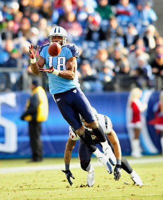 NASHVILLE, TN - DECEMBER 19:  Kenny Britt #18 of the Tennessee Titans makes a catch as Jason Allen #30 of the Houston Texans defends at LP Field on December 19, 2010 in Nashville, Tennessee. The Titans defeated the Texans, 31-17.  (Photo by Grant Halverso