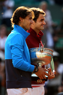 PARIS, FRANCE - JUNE 05:  (L to R) Champion Rafael Nadal of Spain and runner up Roger Federer of Switzerland pose following the men's singles final match between Rafael Nadal of Spain and Roger Federer of Switzerland on day fifteen of the French Open at R