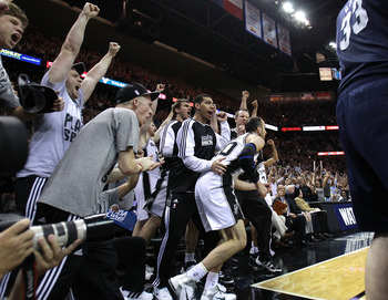 SAN ANTONIO, TX - APRIL 27:  Manu Ginobili #20 of the San Antionio Spurs celebrates with teammates after hitting a two pointer near the end of regulation against the Memphis Grizzlies in Game Five of the Western Conference Quarterfinals in the 2011 NBA Pl