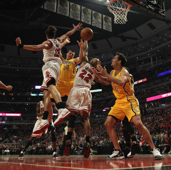 CHICAGO, IL - APRIL 26: Tyler Hansbrough #50 of the Indiana Pacers looses control of the ball under pressure from Joakim Noah #13 and Taj Gibson #22 of the Chicago Bulls as Jeff Foster #10 moves to the ball in Game Five of the Eastern Conference Quarterfi