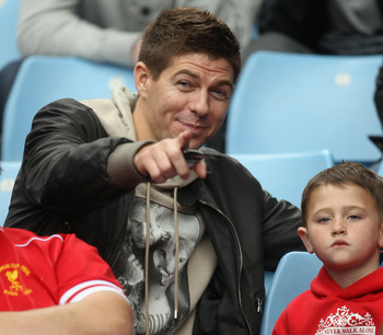 BIRMINGHAM, ENGLAND - MAY 22:  Liverpool Captain Stephen Gerrard watches from the stands during the Barclays Premier League match between Aston Villa and Liverpool at Villa Park on May 22, 2011 in Birmingham, England.  (Photo by Bryn Lennon/Getty Images)