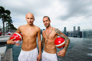 SINGAPORE - JULY 18: In this handout photo provided by Marina Bay Sands, Jonjo Shelvey and Raul Meireles of Liverpool FC pose at the iconic Sands SkyPark, Marina Bay Sands on July 18, 2001 in Singapore. (Photo by Marina Bay Sands via Getty Images)