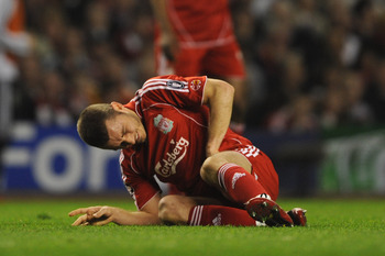 LIVERPOOL, UNITED KINGDOM - APRIL 22:  Fabio Aurelio of Liverpool sustains an injury during the UEFA Champions League Semi Final, first leg match between Liverpool and Chelsea at Anfield on April 22, 2008 in Liverpool, England. (Photo by Shaun Botterill/G