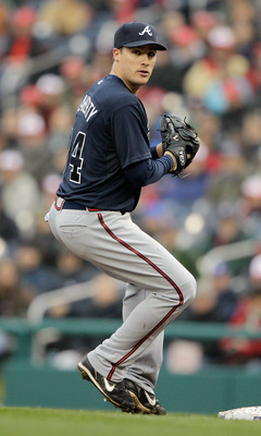 WASHINGTON, DC - MARCH 31: Pitcher Eric O'Flaherty #34 of the Atlanta Braves against the Washington Nationals at Nationals Park on March 31, 2011 in Washington, DC.  (Photo by Rob Carr/Getty Images)