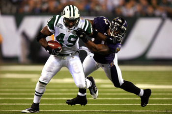 EAST RUTHERFORD, NJ - SEPTEMBER 13:  Tony Richardson #49 of the New York Jets stiff arms Ray Lewis #52 of the Baltimore Ravens during their home opener at the New Meadowlands Stadium on September 13, 2010 in East Rutherford, New Jersey.  (Photo by Andrew