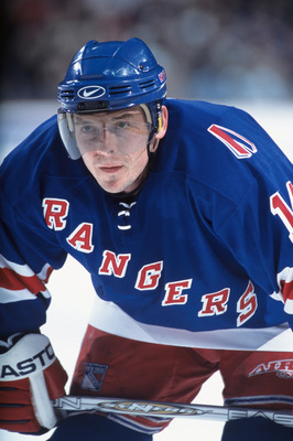 27 Nov 2001:  Left wing Theo Fleury #14 of the New York Rangers waits for the face off during the NHL game against the Buffalo Sabres at HSBC Arena in Buffalo, New York.  The Rangers and Sabres skated to a 2-2 tie.  \ Mandatory Copyright Notice: 2001 NHLI