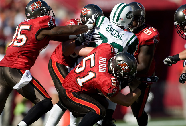 TAMPA, FL - DECEMBER 13:  Running back Shonn Greene #23 of the New York Jets is tackled by Barrett Ruud #51 of the Tampa Bay Buccaneers during the game at Raymond James Stadium on December 13, 2009 in Tampa, Florida.  (Photo by J. Meric/Getty Images)
