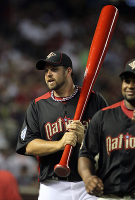 PHOENIX, AZ - JULY 11:  National League All-Star Heath Bell #21 of the San Diego Padres carries a large bat to the field during the 2011 State Farm Home Run Derby at Chase Field on July 11, 2011 in Phoenix, Arizona.  (Photo by Jeff Gross/Getty Images)