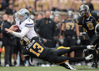 COLUMBIA, MO - NOVEMBER 13:  Quarterback Collin Klein #7 of the Kansas State Wildcats carries the ball as Kenji Jackson #13 of the Missouri Tigers defends during the game on November 13, 2010 at Faurot Field/Memorial Stadium in Columbia, Missouri.  (Photo