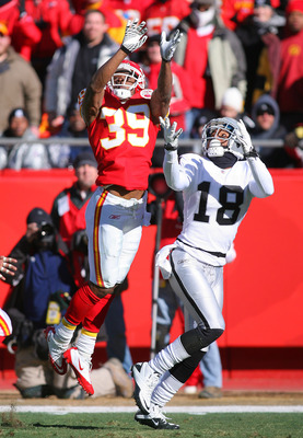 KANSAS CITY, MO - JANUARY 02:  Cornerback Brandon Carr #39 of the Kansas City Chiefs tries to break up a pass intended for wide receiver Louis Murphy #18 of the Oakland Raiders in a game at Arrowhead Stadium on January 2, 2011 in Kansas City, Missouri.  (