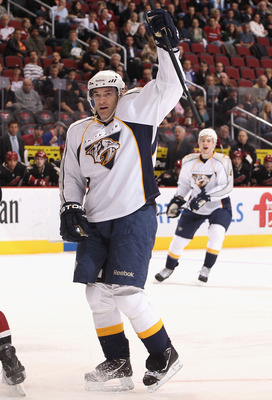 GLENDALE, AZ - JANUARY 18:  J.P. Dumont #71 of the Nashville Predators celebrates after scoring a first period goal against the Phoenix Coyotes during the NHL game at Jobing.com Arena on January 18, 2011 in Glendale, Arizona.  (Photo by Christian Petersen