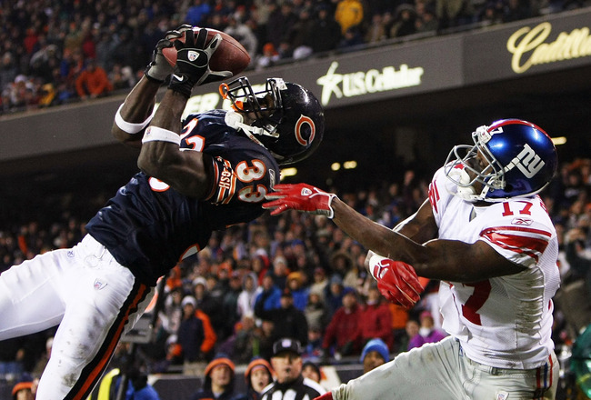 CHICAGO - DECEMBER 02: Charles Tillman #33 of the Chicago Bears intercepts a pass in the end zone intended for Plaxico Burress #17 of the New York Giants on December 2, 2007 at Soldier Field in Chicago, Illinois. The Giants defeated the Bears 21-16. (Phot
