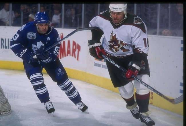 16 Nov 1996:  Center Doug Gilmour of the Toronto Maple Leafs (left) and Phoenix Coyotes defenseman Brad McCrimmon moves down the ice during a game at the America West Arena in Phoenix, Arizona.  The Coyotes won the game, 3-2. Mandatory Credit: Glenn Cratt
