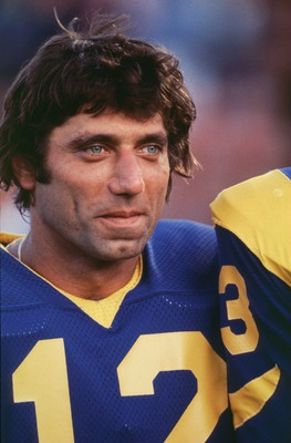 Quarterback Joe Namath of the LA Rams smiles during a game at the LA Memorial Coliseum in Los Angeles, California.