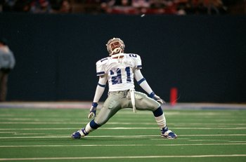 18 Oct 1999: Deion Sanders #21 of the Dallas Cowboys stretches on the field during a game against the New York Giants at the Giants Stadium in East Rutherford, New Jersey. The Giants defeated the Cowboys 16-13. Mandatory Credit: Ezra O. Shaw  /Allsport