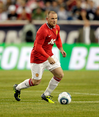 FOXBORO, MA - JULY 13: Wayne Rooney #10 of Manchester United brings the ball down field against the New England Revolution defends during a friendly match at Gillette Stadium on July 13, 2011 in Foxboro, Massachusetts. (Photo by Jim Rogash/Getty Images)
