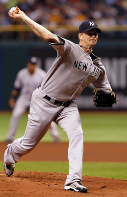 ST PETERSBURG, FL - JULY 18:  :  Pitcher A.J. Burnett #34 of the New York Yankees pitches against the Tampa Bay Rays during the game at Tropicana Field on July 18, 2011 in St. Petersburg, Florida.  (Photo by J. Meric/Getty Images)