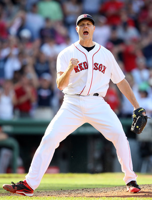 BOSTON, MA - JULY 10:  Jonathan Papelbon #58 of the Boston Red Sox celebrates the win on July 10, 2011 at Fenway Park in Boston, Massachusetts.The Boston Red Sox defeated the Baltimore Orioles 8-6.  (Photo by Elsa/Getty Images)