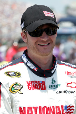 LOUDON, NH - JULY 17: Dale Earnhardt Jr., driver of the #88 National Guard/Amp Energy Chevrolet, waits on the grid prior to the NASCAR Sprint Cup Series LENOX Industrial Tools 301 at New Hampshire Motor Speedway on July 17, 2011 in Loudon, New Hampshire.