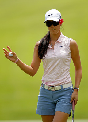 COLORADO SPRINGS, CO - JULY 09:  Michelle Wie waves after making a par putt on the 15th hole during the continuation of second round of the U.S. Women's Open at the Broadmoor on July 9, 2011 in Colorado Springs, Colorado.  (Photo by Mike Ehrmann/Getty Ima