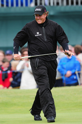 SANDWICH, ENGLAND - JULY 17:  Phil Mickelson of the United States reacts to a missed putt on the 16th hole during the final round of The 140th Open Championship at Royal St George's on July 17, 2011 in Sandwich, England.  (Photo by Stuart Franklin/Getty I