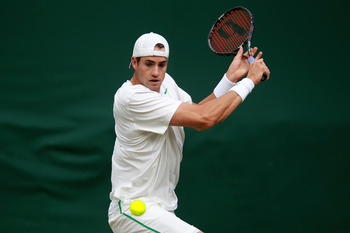 LONDON, ENGLAND - JUNE 23:    John Isner of the United States lines up a shot during his second round match against Nicolas Almagro of Spain on Day Four of the Wimbledon Lawn Tennis Championships at the All England Lawn Tennis and Croquet Club on June 23,
