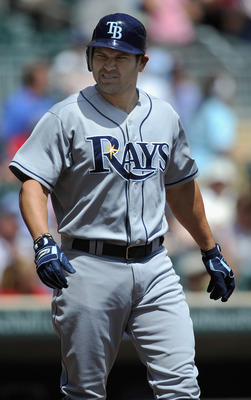 MINNEAPOLIS, MN - JULY 6: Johnny Damon #22 of the Tampa Bay Rays reacts to be hit by a pitch thrown by Francisco Liriano #47 of the Minnesota Twins in the first inning on July 6, 2011 at Target Field in Minneapolis, Minnesota. The Rays defeated the Twins