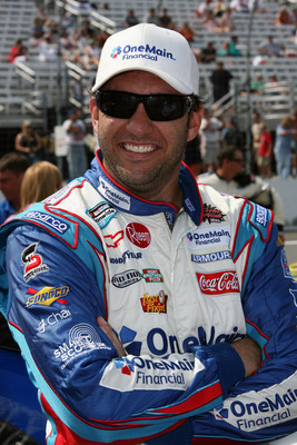 LOUDON, NH - JULY 16:  Elliott Sadler, driver of the #2 OneMain Financial Chevrolet, stands on the grid prior to the NASCAR Nationwide Series New England 200 at New Hampshire Motor Speedway on July 16, 2011 in Loudon, New Hampshire.  (Photo by Jerry Markl