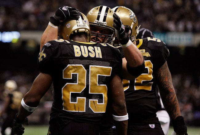 NEW ORLEANS - JANUARY 13:  Reggie Bush #25 of the New Orleans Saints celebrates his touchdown run with Mike Karney #44  in the second quarter against the Philadelphia Eagles during the NFC divisional playoff game at the Superdome on January 13, 2007 in Ne