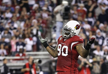 GLENDALE, AZ - DECEMBER 25:  Defensive tackle Darnell Dockett #90 of the Arizona Cardinals reacts after sacking quarterback Jon Kitna of the Dallas Cowboys (not picutred) during the second quarter of the NFL game at the University of Phoenix Stadium on De