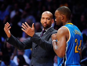 LOS ANGELES, CA - APRIL 20:  Head coach Monty Williams of the New Orleans Hornets talks with Carl Landry #24 while taking on the Los Angeles Lakers in Game Two of the Western Conference Quarterfinals in the 2011 NBA Playoffs on April 20, 2011 at Staples C