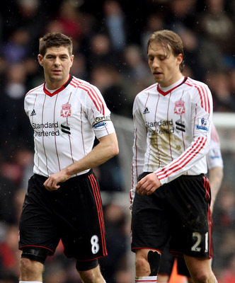 LONDON, ENGLAND - FEBRUARY 27:  Steven Gerrard and teammate Lucas Leiva of Liverpool leave the pitch dejected at half time during the Barclays Premier League match between West Ham United and Liverpool at the Boleyn Ground on February 27, 2011 in London,