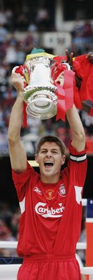 CARDIFF, UNITED KINGDOM - MAY 13:  Steven Gerrard (L), the Liverpool captain, lifts the trophy after being presented with it by HRH Prince William (R) the FA Cup Final match between Liverpool and West Ham United at the Millennium Stadium on May 13, 2006 i