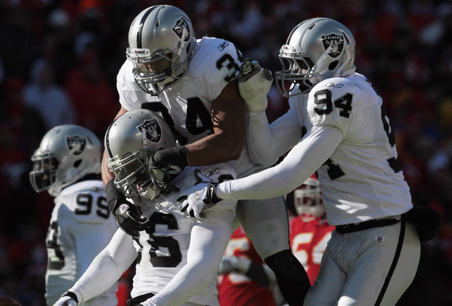 KANSAS CITY, MO - JANUARY 02: Oakland Raiders defensive players celebrate after stopping the Kansas City Chiefs during the game on January 2, 2011 at Arrowhead Stadium in Kansas City, Missouri.  (Photo by Jamie Squire/Getty Images)
