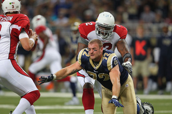 ST. LOUIS - SEPTEMBER 12: Chris Long #72 of the St. Louis Rams looks to get a sack against Brandon Keith #72 of the Arizona Cardinals during the NFL season opener at the Edward Jones Dome on September 12, 2010 in St. Louis, Missouri.  The Cardinals beat t