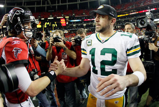 ATLANTA, GA - JANUARY 15:  Quarterback Aaron Rodgers #12 (R) of the Green Bay Packers is congratulated by Matt Ryan #2 of the Atlanta Falcons after the Packers won 48-21 during their 2011 NFC divisional playoff game at Georgia Dome on January 15, 2011 in
