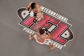 UNCASVILLE, CT - MAY 16:  Joey Guel (Bottom) receives a punch from Matt Horwich (Top) of the Team Quest Fight club during their bout presented by the International Fighting League at the Mohegan Sun Arena May 16, 2008 in Uncasville, Connecticut.  (Photo b