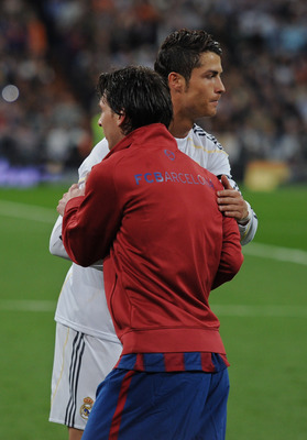 MADRID, SPAIN - APRIL 10:  Lionel Messi (L) of FC Barcelona greets Cristiano Ronaldo of Real Madrid prior to the start of the La Liga match between Real Madrid and Barcelona at the Estadio Santiago Bernabeu on April 10, 2010 in Madrid, Spain. Barcelona wo