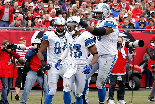 TAMPA, FL - DECEMBER 19:  Receiver Nate Burleson #13 of the Detroit Lions celebrates a touchdown against the Tampa Bay Buccaneers during the game at Raymond James Stadium on December 19, 2010 in Tampa, Florida.  (Photo by J. Meric/Getty Images)