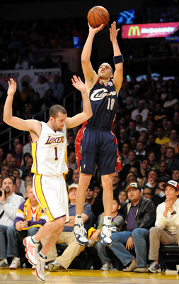 LOS ANGELES, CA - DECEMBER 25: Anthony Parker #18 of the Cleveland Cavaliers puts a shot up over Jordan Farmar #1 of the Los Angeles Lakers at Staples Center on December 25, 2009 in Los Angeles, California. NOTE TO USER: User expressly acknowledges and ag