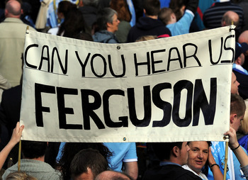 MANCHESTER, ENGLAND - MAY 23: Manchester City fans display a banner during the Manchester City FA Cup Winners Parade at Manchester Town Hall on May 23, 2011 in Manchester, United Kingdom.  (Photo by Chris Brunskill/Getty Images)